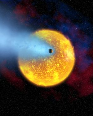 Wizja artystyczna  planety HD 209458 b i jej atmosfery / Credits - ESA, Hubble