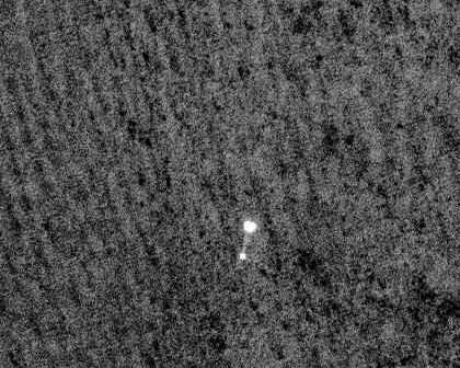 Phoenix Mars Lander widziany z orbity Marsa (NASA)