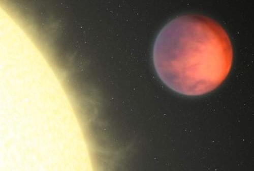 Wizja artystyczna planety pozasłonecznej Ypsilon Andromedae b obiegającej swoją młodą gwiazdę podobną do Słońca (NASA/JPL-Caltech)
