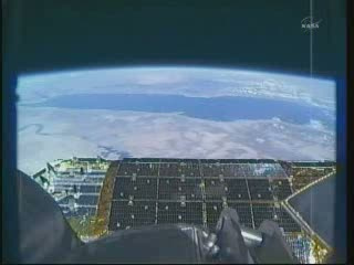 Widok z ramienia SSRMS - 12:25 CET / Credits - NASA TV