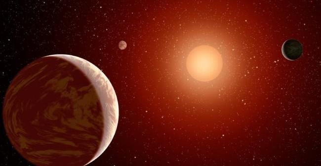 Wizja artysty – czerwony karzeł otoczony trzema planetami / Credit - NASA/JPL-Caltech