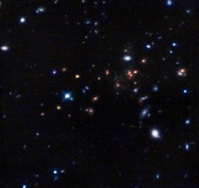 Zdjęcie gromady w bliskiej podczerwieni wykonane Teleskopem Hubble`a / Credit - NASA/ESA/R. Gobat et al.