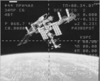 Obracająca się Międzynarodowa Stacja Kosmiczna, na dole widoczny eruopejski pojazd zaopatrzeniowy Johannes Kepler (NASA TV)