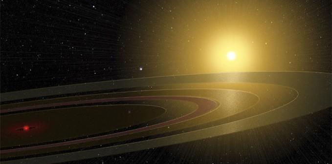 Artystyczna wizja pierścieni otaczających pewne ciało centralne. Całość orbituje wokół młodej gwiazdy / Credit - Michael Osadciw/University of Rochester
