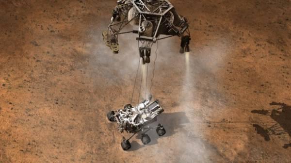 Artystyczna wizja lądowania łazika Curiosity na Marsie przy wykorzystaniu platformy SkyCrane / Credits: NASA