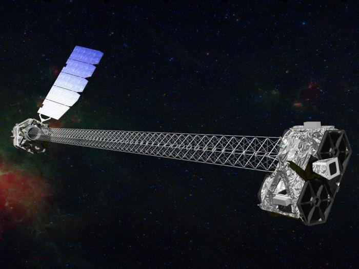 Wizja artystyczna obserwatorium NuSTAR z charakterystycznym 10-metrowym masztem / Credits: NASA/JPL-Caltech