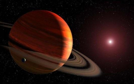 Egzoksiężyc krążący wokół gazowego giganta / Credits - NASA/ESA/G.Bacon (STScI)