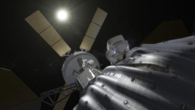 Grafika prezentujaca MPCV Orion przycumowany do przechwyconej planetoidy / Credits - NASA