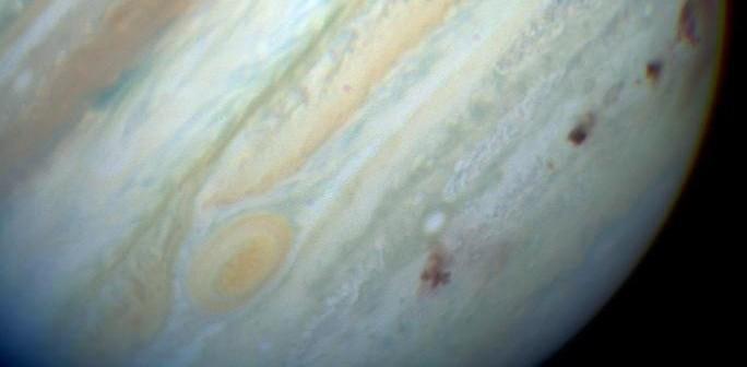 Jowisz po uderzeniach komety S-L 9 / Credits - NASA, ESA, HST