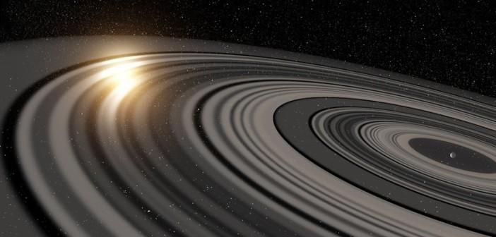 Wizja pierścieni wokół J1407b przesłaniających gwiazdę układu / Credits - Rob Miller