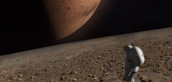 Wizja lat 30. XXI wieku? Astronauta spogląda na Marsa z powierzchni Fobosa / Credits - NASA