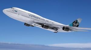 LauncherOne pod skrzydłem Jumbo Jeta - wizualizacja / Credit: Virgin Galactic