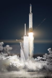 Grafika prezentująca startującą rakietę Falcon Heavy / Credits - SpaceX