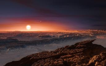 Wizja artystyczna powierzchni planety Proxima b, orbitującej wokół czerwonego karła Proxima Centauri. W tle widoczne pozostałe dwie gwiazdy tego układu wielokrotnego Alfa Centauri AB. (ESO/M. Kornmesser)