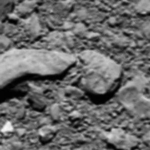 """Zrekonstruowane ostatnie """"pół zdjęcia"""" z sondy Rosetta / Credits - ESA/Rosetta/MPS for OSIRIS Team MPS/UPD/LAM/IAA/SSO/INTA/UPM/DASP/IDA"""